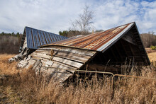 Old Twisted And Leaning Abandoned Barn