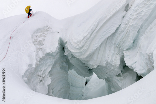 Fotografie, Obraz Mountain climber climb ice bridge (glacier)