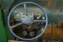 Steering Wheel And Dash Of Old Abandoned School Bus