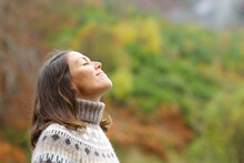 Middle Aged Woman Breathing Fresh Air In A Forest
