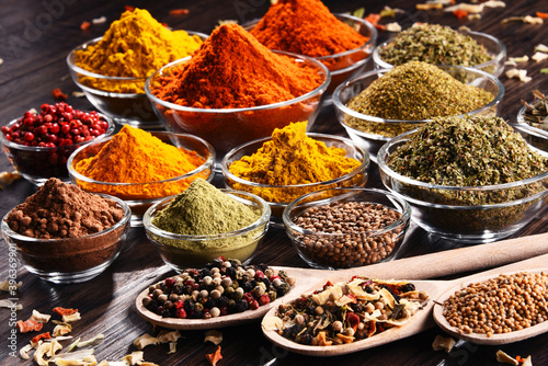 Fototapety, obrazy: Variety of spices and herbs on kitchen table