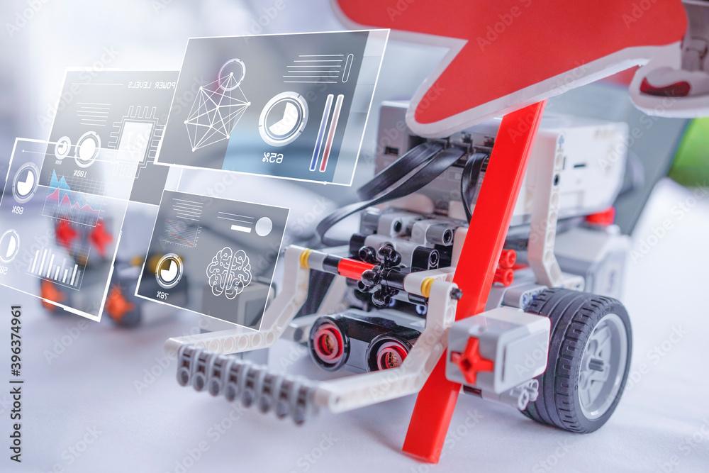 Fototapeta Toy Lego smart robot AI artificial intelligent Stem school kids learning education technology building block creative ideas construction development programming analysis, graphical icons UI screen