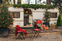 Caravan Mobile Home With Terrace, Mobile Home Decorated With Christmas Decor. Festive Atmosphere - Lights, Red Blankets, Christmas Trees. Waiting For The Snow. Caravan Camping. Mobile Home Trailer