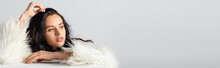 Brunette Young Woman In Faux Fur Jacket Posing Near Cube On White Background, Banner