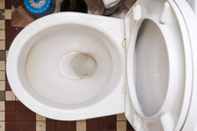 Dirty Unhygienic Toilet Bowl With Limescale Stain At Public Restroom, Top View
