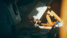 Close Up Of Woman Sharpening Pencil In The Sun
