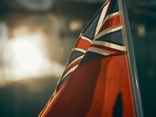 British Nautical Flag In The Sun In Marina