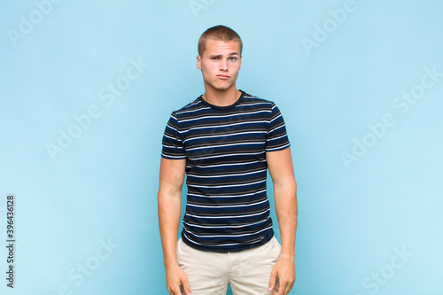 Photo blonde  man looking goofy and funny with a silly cross-eyed expression, joking a