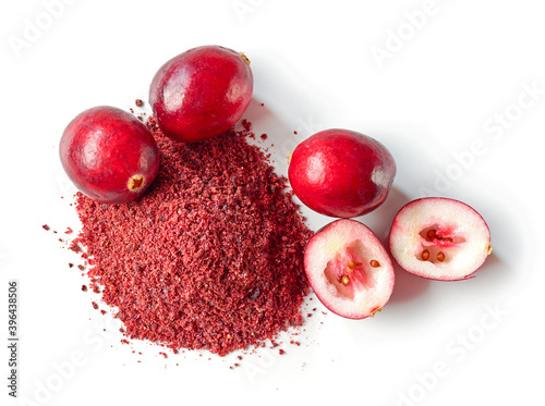 Fototapeta dried cranberry powder and fresh cranberries obraz