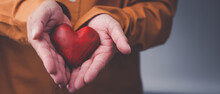 Male Hands Holding Red Heart, World Mental Health Day And World Heart Day, Life And Health Insurance, Concept Of Love.