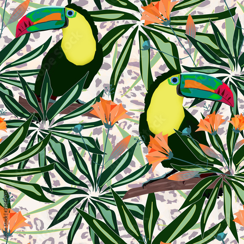 Fototapeta premium Seamless tropical pattern. Toucan birds with palm leaves on a beige leopard background.