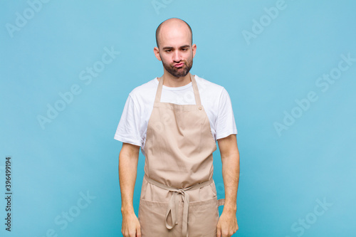 Платно bald man looking goofy and funny with a silly cross-eyed expression, joking and
