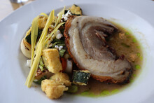 Dinner At An Upscale Restaurant Of Duck Breast Plated With A Vegetable Medley