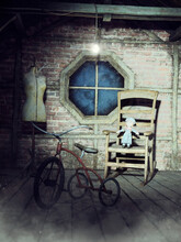 Old Dusty Attic Room With A Bike, Rocking Chair, Doll, And Other Vintage Objects. 3D Render.