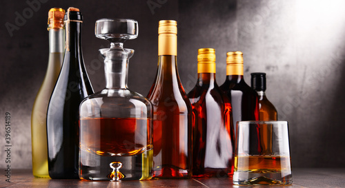 Fototapety, obrazy: Carafe and bottles of assorted alcoholic beverages.