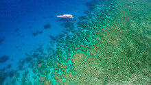 Drone Flight Over The Beautiful Great Barrier Reef With An Lonely Small Ship