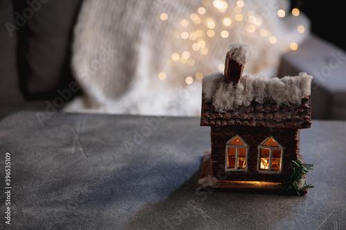 Leinwand Poster House miniature illuminated against grey background