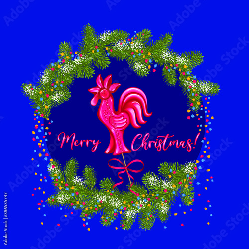 New Year card with a red lollipop in the shape of a cockerel around branches of a Christmas tree, snow and confetti on a dark blue background Poster Mural XXL