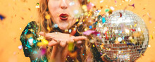 Happy Fashion Girl Blowing Confetti Holding Vintage Disco Ball - Party Concept - Focus On Mouth
