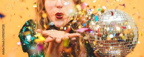 Fotografía Happy fashion girl blowing confetti holding vintage disco ball - Party concept -