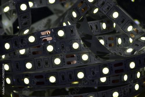 Fototapety, obrazy: Glowing in the dark LED strip on a dark background.