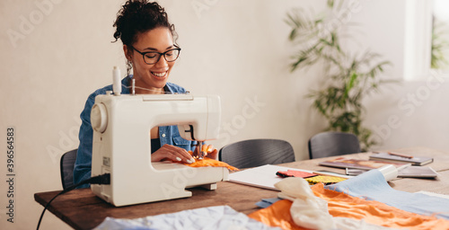 Fototapeta Woman sewing face mask for covid at home