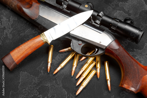 Leinwand Poster Close up of hunting shotgun and cartridges on dark grey background