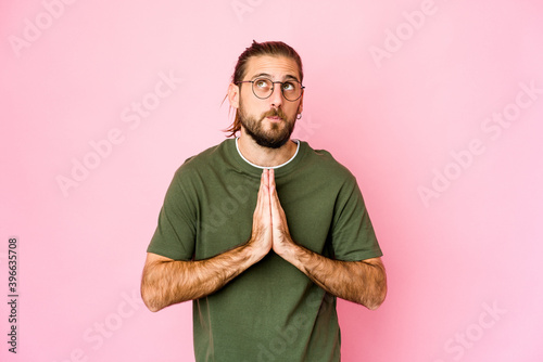 Young man with long hair look praying, showing devotion, religious person looking for divine inspiration Fototapet
