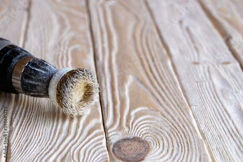Electrical drill with a circular metallic wire brush lying on the treated surfac Canvas Print