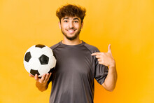 Young Soccer Player Indian Man Person Pointing By Hand To A Shirt Copy Space, Proud And Confident
