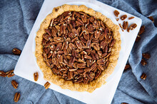 Overhead View Of Pecan Pie On Cutting Board