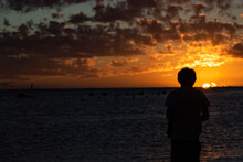 Male Watches Sunset Over The O...
