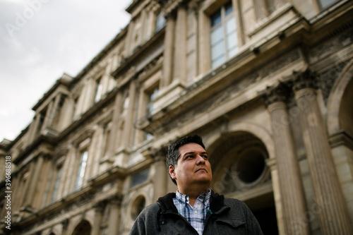 Canvas Print Low View of Man Standing Outside the Louvre in Paris