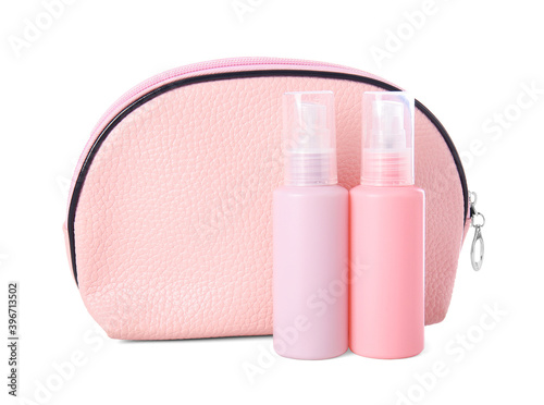 Fototapeta Set of travel bottles with body care cosmetics and cosmetic bag on white background obraz