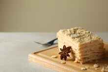 Wooden Board With Piece Of Napoleon Cake With Cinnamon, Close Up