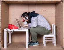 Employee Works From His Own Cardboard Office To Isolate Himself From Others