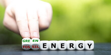 """Hand Turns Dice And Changes The Expression """"fossil Energy"""" To """"green Energy""""."""