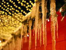 Icicles Hang From The Roof Of ...