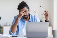 Eyes Fatigue. Young Freelancer Guy Massaging Nosebridge, Tired After Working On Laptop