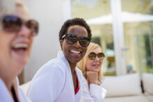 Portrait Happy Senior Women Friends In Spa Bathrobes And Sunglasses