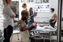 Designer Using Digital Tablet In Creative Meeting