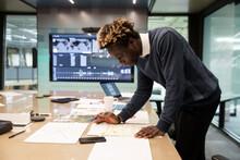 Man Planning Work On Meeting Room Table