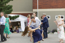 Playful Wedding Guests Dancing At Reception Party