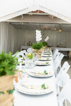 Long Table Set For Wedding Reception In Tent