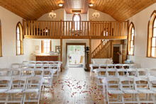 Rose Petals On Floor Of Church Decorated For Wedding
