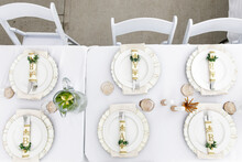 Placesettings And Monogram Napkins On Table At Wedding Reception