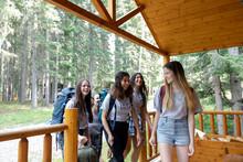 Girls Arriving At Cabin At Summer Camp