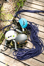Pile Of Climbing Rope, Harnesses And Helmets
