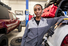 Portrait Confident Female Auto Mechanic In Garage