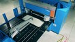 Automated factory machine is bending an aluminum plate
